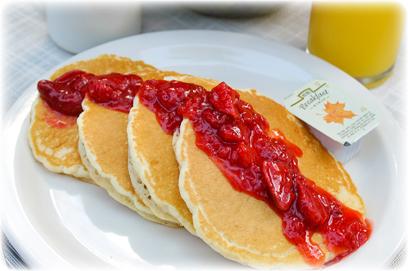 Buttermilk pancakes (banana, strawberry, or chocolate sauce!)