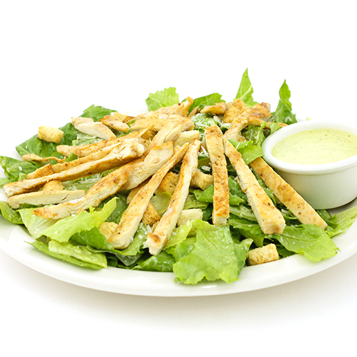 Caesar salad with parmesan cheese, croutons and chicken